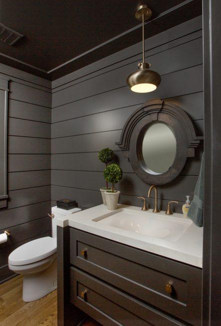 Стильный интерьер гигиенической комнаты в темных тонах