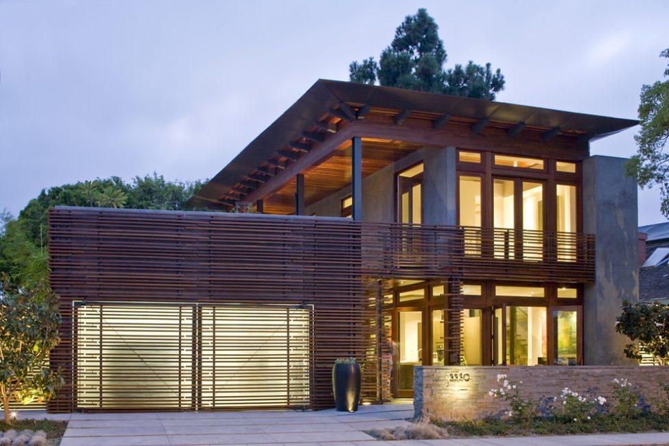 Внешняя отделка гаража должна гармонировать с декорированием фасада дома