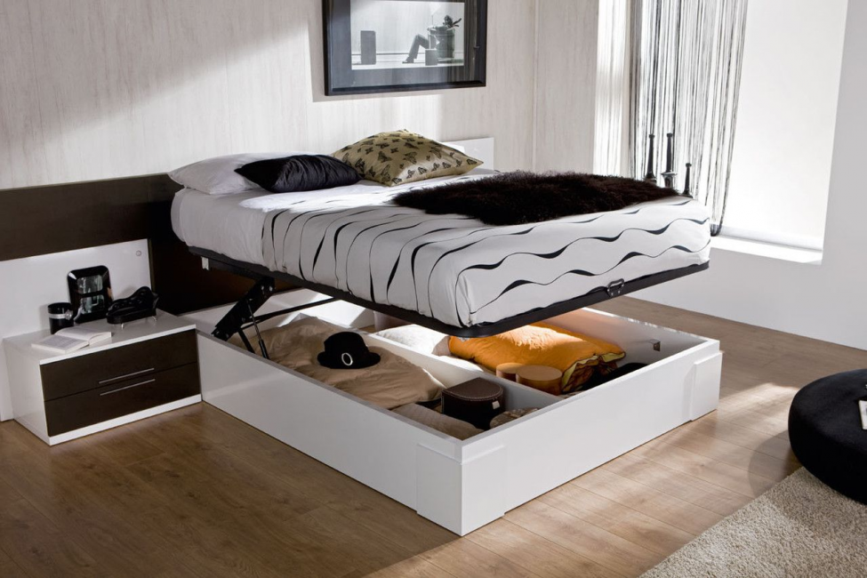 Ящик, который состоит из отсеков, дополнительно укрепляет короб кровати