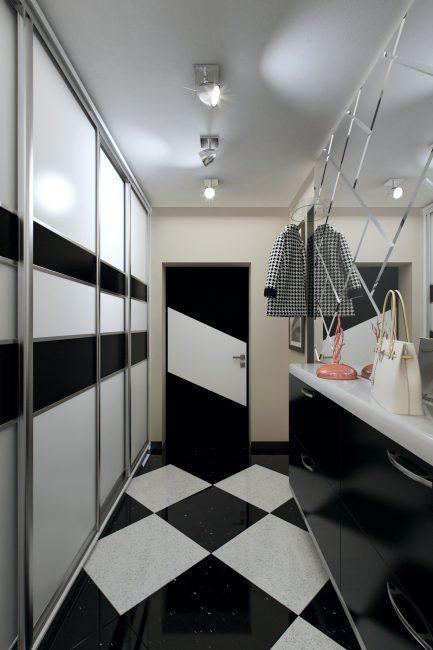 Точечное освещение в коридоре оформлено в стиле модерн