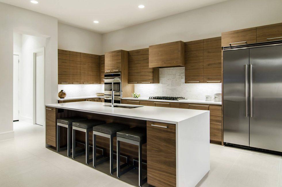 Мебель в такой кухне отличается монохромной поверхностью