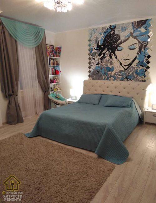 В спальной зоне поставили большую белую кровать, над изголовьем которой повесили огромную картину в виде портрета девушки. Шторы и покрывало также подобрали в тон комнаты.