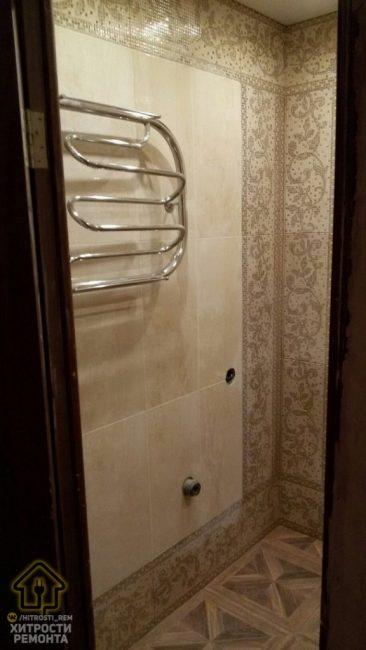 Полотенцесушитель подобрали довольно оригинальный. Он выгнутый, чтобы на нем удобнее было располагать полотенца, и они быстрее сохли.
