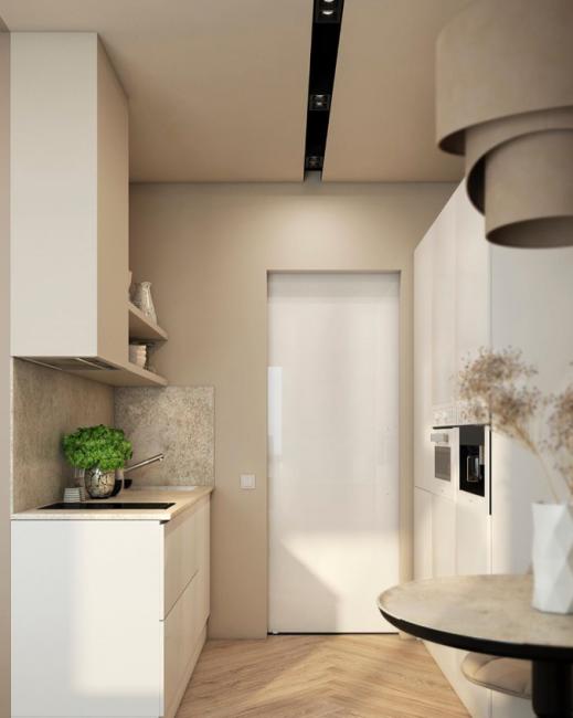 Под стать кухонному гарнитуру сделаны и двери. В целом, кухня выглядит довольно аскетично и стильно.